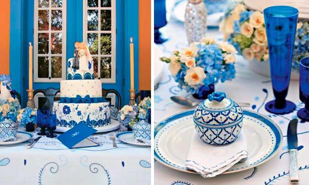 Mesa decorada em azul com detalhes de louças portuguesas