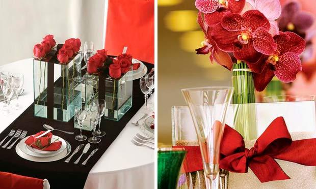 Mesa com toalha preta e rosas vermelhas e vaso de vidro com laço vermelho