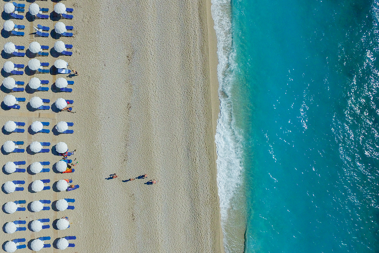 LEFKADA, GREECE - JUNE 08: Aerial view of umbrelas and people who enjoy the Kathisma beach on June 08, 2016 in Lefkada,Greece. (Photo by Athanasios Gioumpasis/Getty Images)