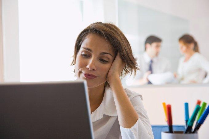 Bored businesswoman using laptop computer