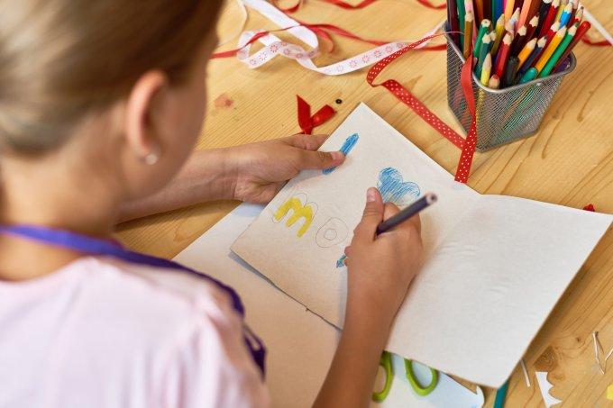 Girl Making Handmade Card for Mom