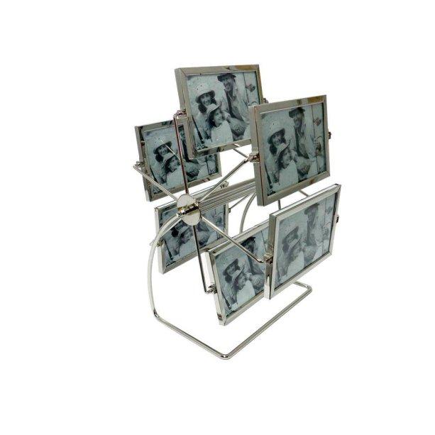 "Porta-retrato giratório de alumínio, nas medidas 6 x 24 x 26 cm, com seis suportes dupla-face para fotos de 10 x 15 cm. <a href=""https://www.americanas.com.br/produto/15113695/porta-retrato-aluminio-giratorio-gdxk5519?WT.srch=1&acc=e789ea56094489dffd798f86ff51c7a9&epar=bp_pl_00_go_mv_todas_geral_gmv&gclid=EAIaIQobChMIo8GxxY2j4QIVlISRCh3k_gSUEAkYASABEgIgyfD_BwE&i=573fe26beec3dfb1f8014408&o=57e5600deec3dfb1f8242784&opn=YSMESP&sellerId=14068763000189"" target=""_blank"" rel=""noopener"">Americanas</a>, R$ 94,90"