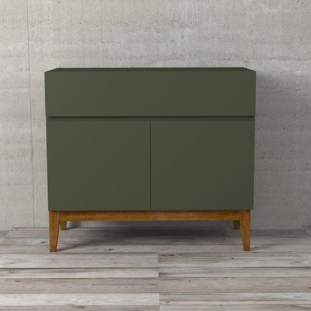 """Gabinete Klein Verde, de MDF com pés de madeira maciça, nas dimensões 85 x 42 x 75 cm. <a href=""""https://www.etna.com.br/p/gabinete-para-banheiro-klein-verde-85x42x75cm/0426373"""" target=""""_blank"""" rel=""""noopener"""">Etna</a>, R$ 799,90"""