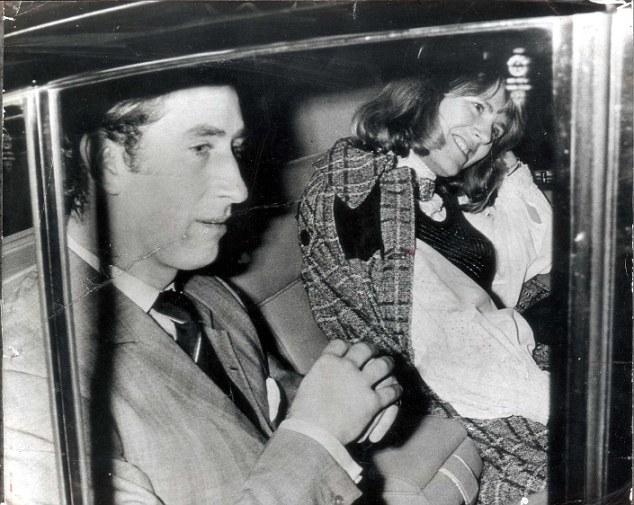 PKT 458 - 91051 LP3D PRINCE OF WALES - GIRLFRIENDS (CAMILLA PARKER-BOWLES) 13th FEBRUARY 1975 CHARLES AND CAMILLA (LEFT) LEAVE THEATRE NOTE: ANDREW PARKER BOWLES BEHIND CHARLES. A night out in the West End for Prince Charles and a laughing friend. The girl sharing the back seat of Prince Charles car last night is Lord Ashcombe's niece, Mrs Camilla Parker-Bowles, wife of Charles polo-playing friend, Major Andrew Parker-Bowles. Last week the Prince was godfather to their first child. They went to see 'Deja Revue', starring Sheila Hancock, and George Cole. The Prince, taking a night off from the Navy, laughed a lot - especially during a saucy scene in which actress Anna Dawson strips down to stockings suspenders.