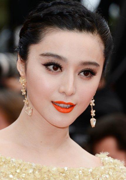<strong>Fan Bingbing:</strong> a atriz chinesa sabe das coisas e sempre aposta no batom laranja vivo para contrastar com sua pele branquinha.