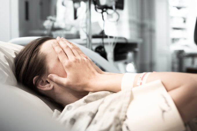 Stressed young woman patient at the hospital