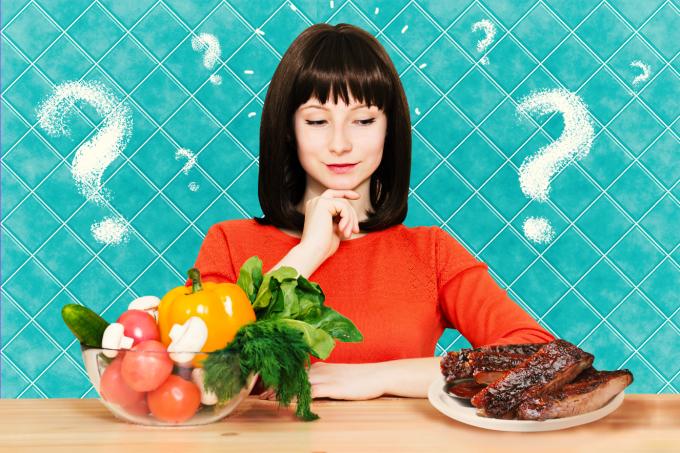 Mulher pensando sobre parar de comer carne