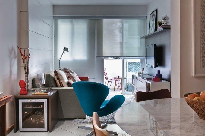 Projeto de apartamento aposta em marcenaria planejada sala estar
