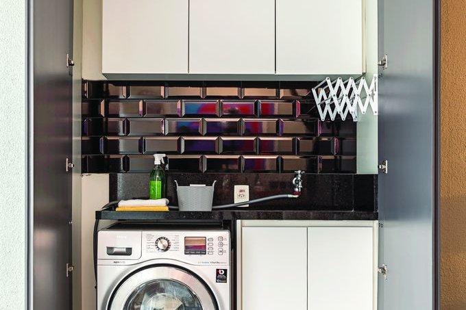 Salas integradas à varanda marcam o projeto deste apê de 60 m² lavanderia
