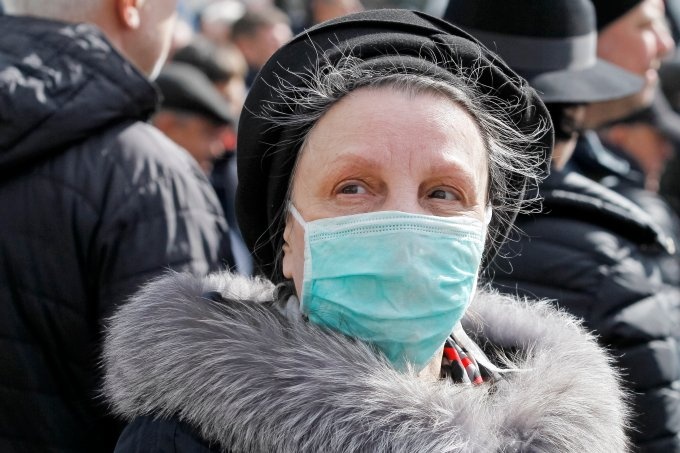An elderly woman wearing a protective mask as a preventive
