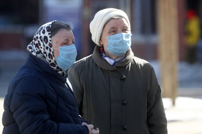 People wearing face masks in Moscow