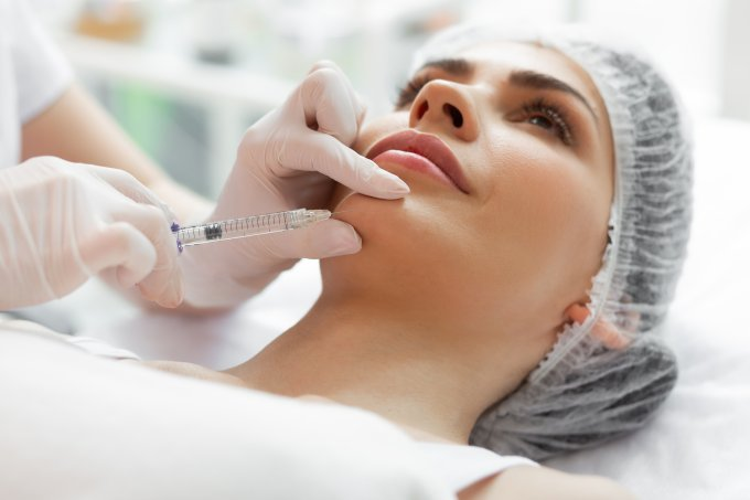 Close up of a female face during the injection