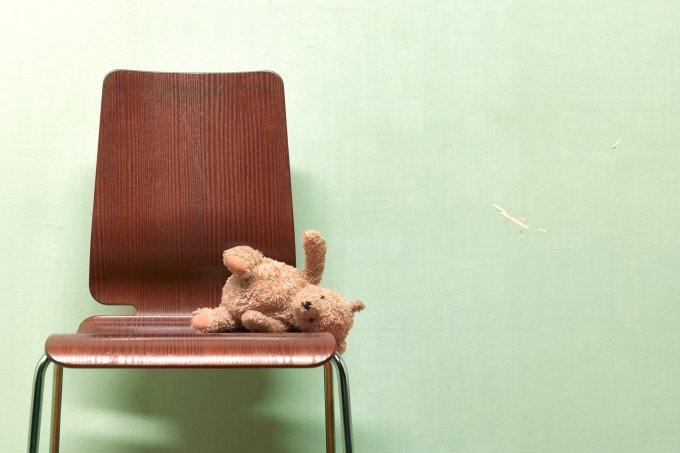 CHILDS FORGOTTEN, ABANDONED TEDDY ON CHAIR