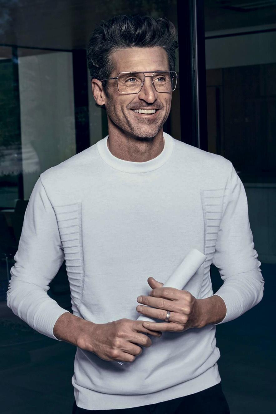 Patrick Dempsey de blusa de lã e óculos