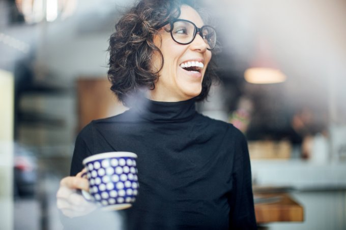 Cheerful businesswoman at coffee shop