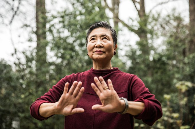Senior woman doing Tai Chi outdoors
