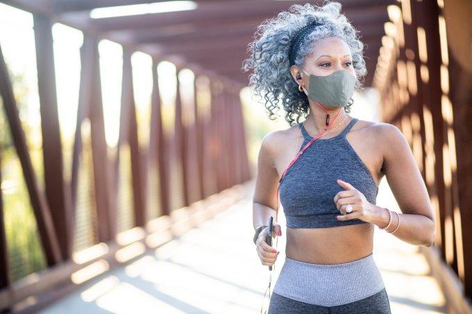 A Black Woman Running on a bridge