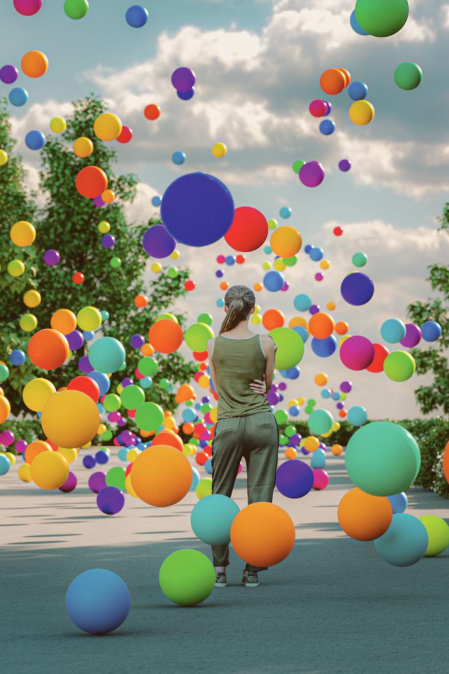 mulher olha para o horizonte cercada de bolas coloridas